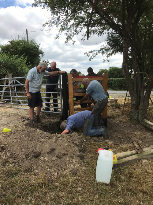 The E-Team installing Pte Harry Smith gate
